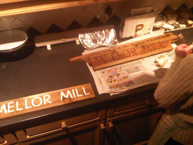 Making the signs.